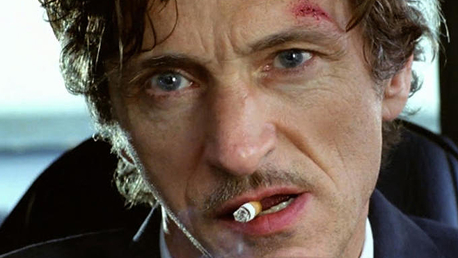John Hawkes smoking a cigarette (or weed)