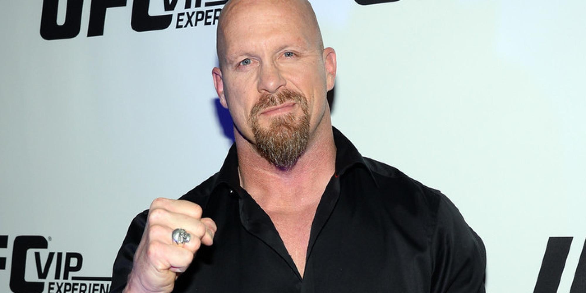 "LAS VEGAS, NV - FEBRUARY 22:  Actor and WWE personality ""Stone Cold"" Steve Austin attends the UFC 170 event at the Mandalay Bay Events Center on February 22, 2014 in Las Vegas, Nevada.  (Photo by Ethan Miller/Getty Images)"