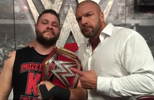 Kevin Owens as WWE Universal Champion & Triple H