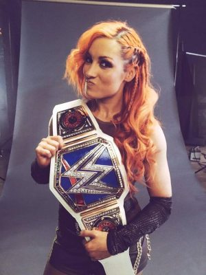 becky-lynch-with-wwe-smackdown-womens-championship-belt