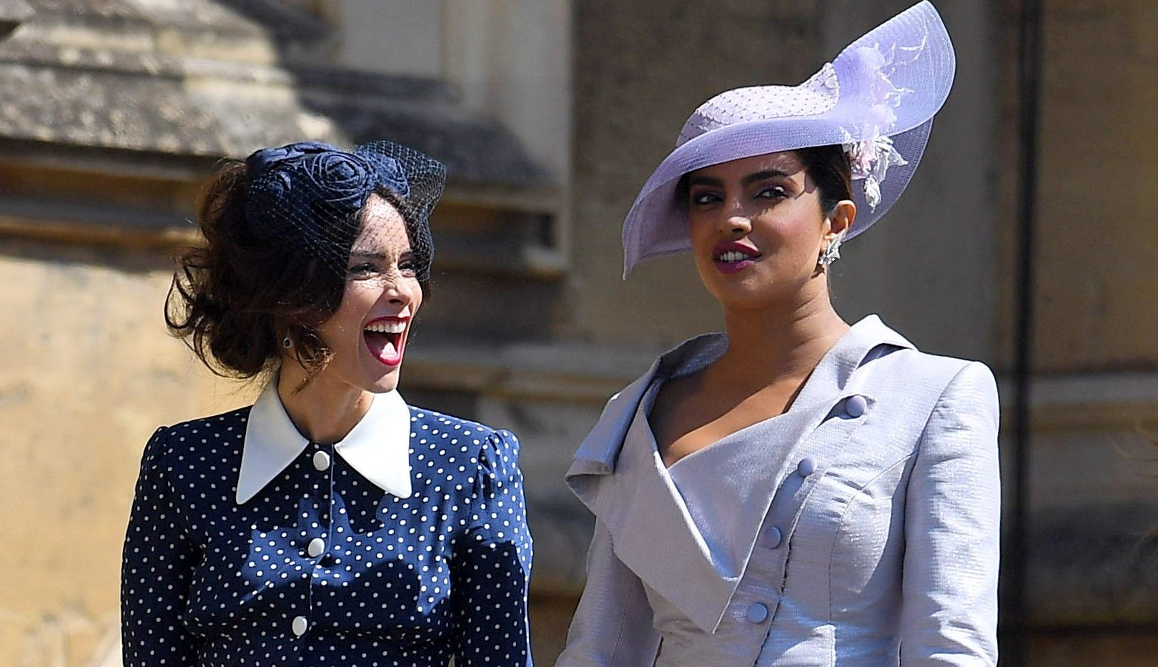 Abigail Spencer and Priyanka Chopra wearing fascinators